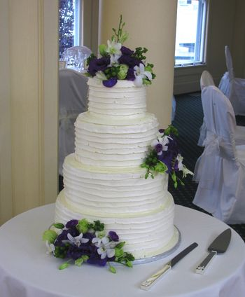 Bride found this similar icing design in a magazine.  Thought it was very unusual and not expectionally pretty.  That was until it was completed and after I put the flowers on.  Now it's one of my favorites.  TFL!!!
