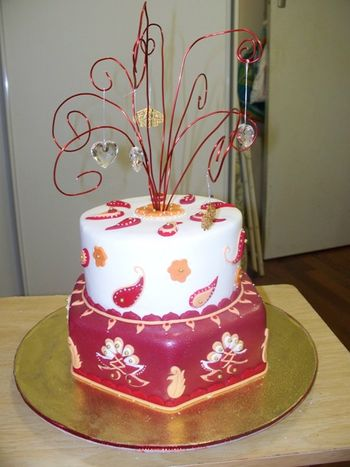 I tried to copy this cake from a pic I saw of one of kake-girl's numbers.  I was turning the big 50 and having a bollywood themed party for the event.  I really enjoyed doing this cake.