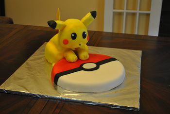 This is my second attempt at a sculpted cake.  I used the cake for 3D modeling recipes here on CakeCentral (vanilla for the Pokeball and chocolate for Pikachu), a mixture of homemade and Fondarific fondant, and a simplified swiss meringue buttercream.