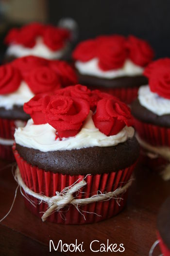 Chocolate cupcake with vanilla frosting and hand rolled fondant roses.