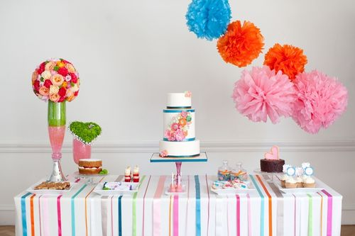 A dessert table for a styled 50's bridal shoot. Photo by http://www.carohutchingsphotography.com/  As featured on the Amy Atlas blog: http://blog.amyatlas.com/2012/04/colorful-floral-guest-dessert-feature/  Floral double barrel wedding cake with ranunuculus, peony and rose. Also on the table are a Victoria sponge, triple chocolate cake, trifle shots, apple pie cupcakes, milk chocolate, cake pops, sugar cookies and bakewell slices.  More photos and credits, www.facebook.com/sugaredsaffron