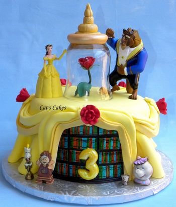 This is the background cake I made to go with the figurine playset for my granddaughters birthday this weekend! She is Belle crazy so we built the party around B&B.  Lemon chiffon cake covered in MMF. Library shelves are handpainted fondant.