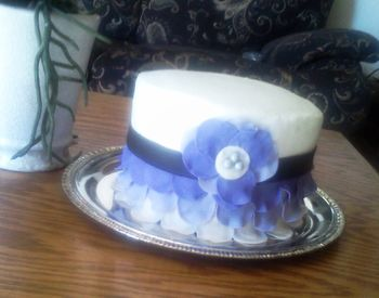 This was a cake that i made for my son?s ?friend?, the cake was covered with almond icing and the petals were made on fondant with lemon flavor