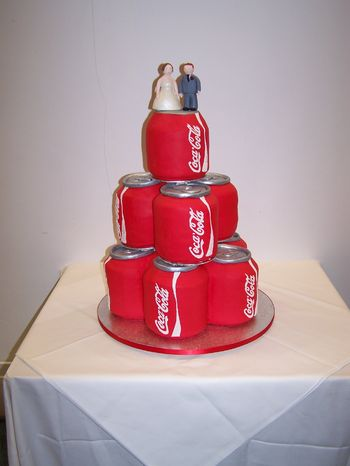Wedding cake for a Coke addict. Covered in sugar paste, made of chocolate fudge cake, rainbow layered cake, carrot cake, lemon cake and rice crispie cake. Writing done with royal icing.