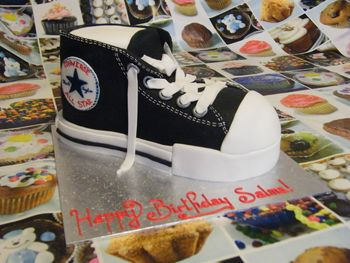 Sponge cake converse shoe, covered in sugar paste, laces in modelling paste.