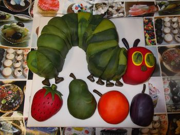 Very Hungry Caterpillar and fruits made from sponge cake and covered in marbled fondant.