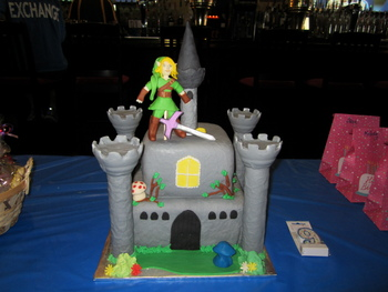 Legend of Zelda Cake. Vanilla/Almond cake, fondant covered. All items made of fondant, except for towers. Covered in fondant, but they are the platic towers from Wilton castle set.