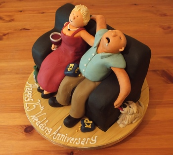 This was a great fun little 8x4 inch sofa cake. Since the figures would make up such a big part of a slice I used 100% modelling choc so that they tasted good :) The story is that Dad falls asleep eating his peanuts and the dog waits by the chair to lick the salt off his fingers when his arm flops down!