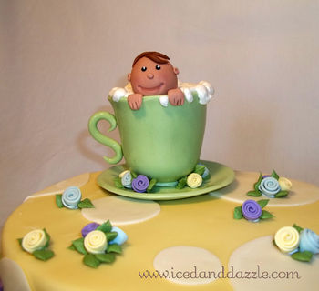 """Baby shower cake to compliment the invitiation/party decor. Gumpaste teacup and baby boy. Cake is a 10"""" Carrot Cake with Very Vanilla Buttercream. I absolutely loved doing this cake and could barely bring myself to part with my cute little baby! TFL!"""