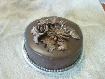 Chocolate cake with modeling chocolate accents