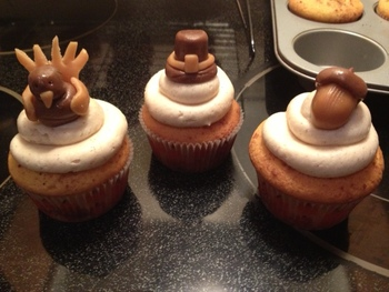 Cinnamon Swirl cupcakes with a Cinnamon buttercream and Thanksgiving toppers made out of tootsie rolls and caramels!