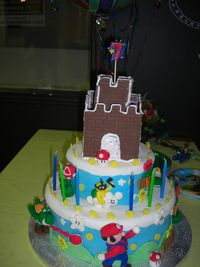 My son wanted a Mario cake. This was my first time making figures, but it turned out okay. He loved it so that's what matters! All fondant decorations, besides the chocolate castle. Which was a huge hit, all the kids wanted to eat the castle!