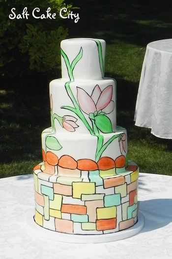 Hand-painted stained glass wedding cake. It was modeled after another cake the bride had seen. I used marshmallow fondant to cover the cake and then hand-painted the design with food coloring.