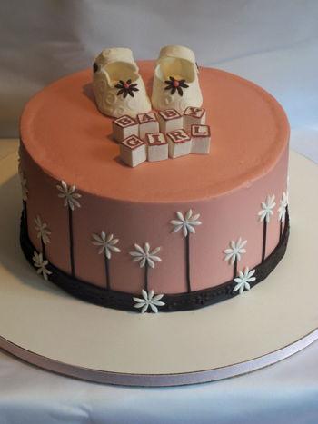 Baby Shower cake. Dairy-free, 4-layers of almond cake with dark chocolate ganache filling.
