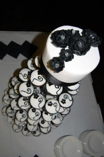 Rethus Wedding Handmade flowers on both cutting cake and 120 mud cupcakes. Much improved on my first attempt!