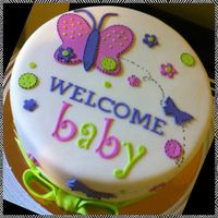 Baby shower cake . Carrot cake, covered in MMF, MMF decorations.