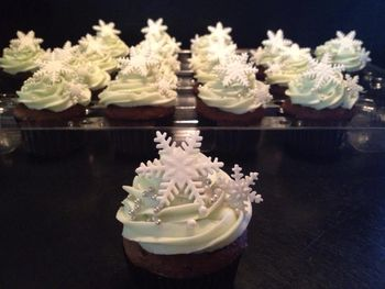 Snowflake Cupcakes . Snowflakes done with PME cutter.