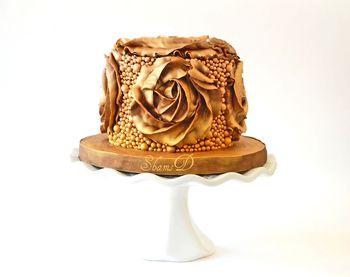 Chocolate Mud Cake with Chocolate ganache.Sprayed bronze and gold.