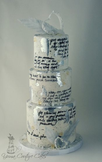 This was a cake I made last year for Valentine's Day. Handwritten love letter (provided by client for his sweetie), isomalt details, gum paste ruffly hearts, rice paper feathers, rock candy, silver gilding