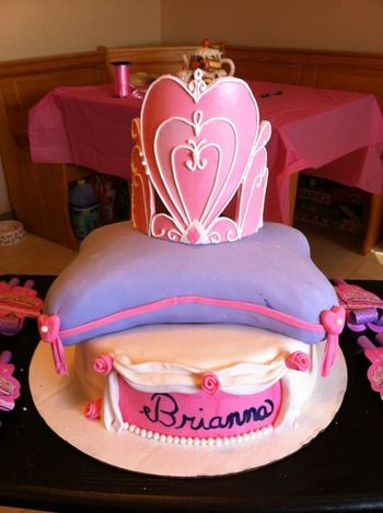 10' round chocolate cake with a 10' square pillow handcarved cake and a Fondant crown pipped with royal icing.
