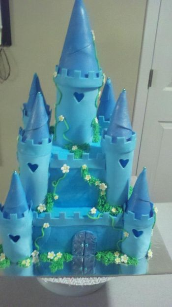 * Blue castle cake. Turrets are fondant/gumpaste mix. 8 inch square cake with 5 inch square on top, all vanilla. This took a really long time to make but I think it turned out really well.