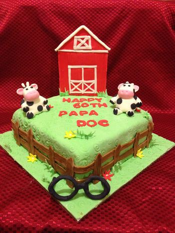 My customer was a retired Eye doctor and currenty was a Cow Farmer.  Cake is Lemon Chiffon with Lemon Curd filling covered in Fondant. Barn is Fondant/Tylose Powder combination, Cows and fence pure fondant. If you look Close the cows are wearing glasses!  =-)