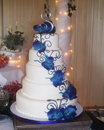Her theme was peacock but she didn't want any feathers on the cake. White chocolate.