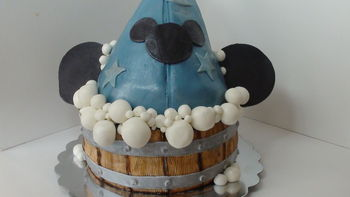 www.thecrumbcoat.wordpress.com I made this cake for my little guy's 4th birthday. The hat is cake covered in mmf, ears are modeling chocolate, bubbles and wood panels are also mmf.