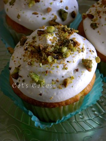 Yellow cake cupcakes filled with Pistachio creme topped with soft butter cream and sprinkled with roasted salted pistachios.