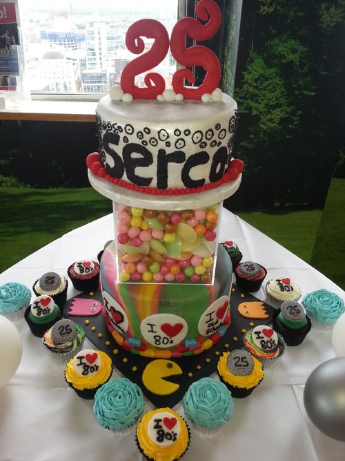 My first chargable order, this was for a company's 25th anniversary/man nesters 80's themed night. Two tier cake with 75 cupcakes :-)