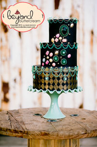Honored to have been put on the cover of the March 2013 issue.  This is a mish mash of stringwork techniques. gumpaste gems, isomalt gems, embossing and handpainting.  I LOVE this cake.