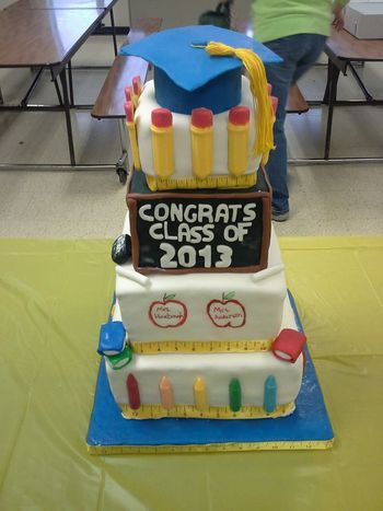 "* Cake for my niece's class for their graduation from elementary school. Pencils and crayons are candy melts.  We allowed my niece to do the doodles on the plain tier and on the ""chalk board"""