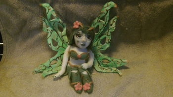all 50/50 gumpaste and fondant.Airbrushed then hand painted wings with branches and petal dust highlights.