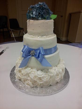 All layers vanilla cake with vanilla buttercream.  Handmade gumpaste flowers.