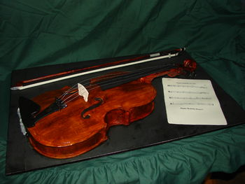 """This cake is up for review by the PRCC. I wanted to give my son a meaningful """"wow"""" cake for his 15th birthday. I chose the Viola since it's his instrument of choice in Advanced Orchestra. Everything is edible, even the strings. I enlarged a template to get the true sizing of a 16"""" viola. The neck was a PITA to make, the tuning pegs work and I had fun making it. There are several things I would do differently and some things I may need you all to point out. TIA. It's a Red Velvet Key Lime cake with IMBC."""