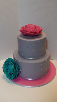 """Gumpaste """"fantasy"""" peonies on gray fondant with white, turquoise and magenta polka dots."""