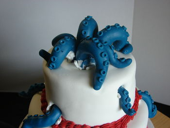 This is my Cthulhu cake.  The cake is covered in MMF. The tentacles are MMF with Tylose powder added.