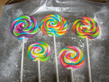 These lollipops are for a Candy Shoppe Theme cake I am doing in two weeks.  They are made with MMF and Tylose powder added.  I am so happy with the way they came out.
