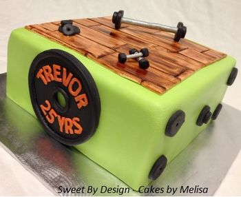 "8"" red velvet covered in fondant, painted fondant wood floor, weights, dumbells."