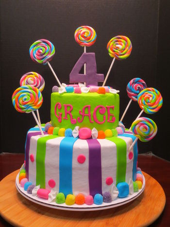 "I had so much fun doing this bright and colorful birthday cake.  All the accents are made from MMF.  I love the lollipops and ""wrapped candy"".  The base of each cake is MMF gumdrops and the wrapped candy."