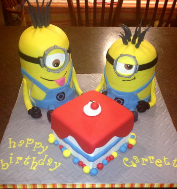 Two minions and a cake - thank you to all the cc'ers before me for creating such a CUTE cake!! The minions are 6in rounds, with a 1/2 ball pan on top.  I used SPS plates as dividers but used a dremel to reduce the size of the SPS plates.  The square is a 6in as well.  Diamond Plate impression mat on the cake base