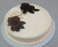 homemade Modeling Chocolate roses, (milk choc clay, dark choc clay, white chocolate clay,)Swiss Meringue Buttercream