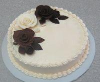 homemade Modeling Chocolate roses, (milk choc clay, dark choc clay, white chocolate clay,)Swiss Meringue Buttercream