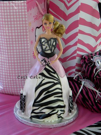 Zebra striped marble cake filled with chocolate brownie buttercream and vanilla buttercream and covered in MMF and candy pearls.