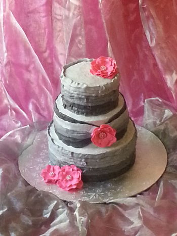 Buttercream ombre cake with gumpaste flowers.