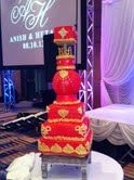 My first wedding cake EVER.  It happened to be for an Indian wedding.  The bride wanted to match her outfit to the cake which gave me the basis for color and design of the wedding cake.