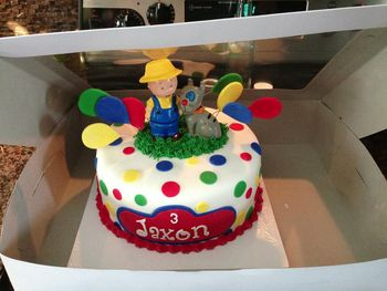 Caillou themed birthday cake.  10 inch peanut butter and jelly cake.