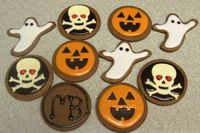 cocoa cookies, Gemini glace icing, white modeling choc skulls dark choc pumpkin faces.