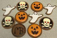 cocoa cookies, Gemini glace icing, white modeling choc skulls dark choc pumpkin faces.