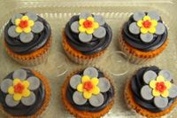 homemade modeling chocolate flowers.  colors are not deeply saturated enough, will do better next time.